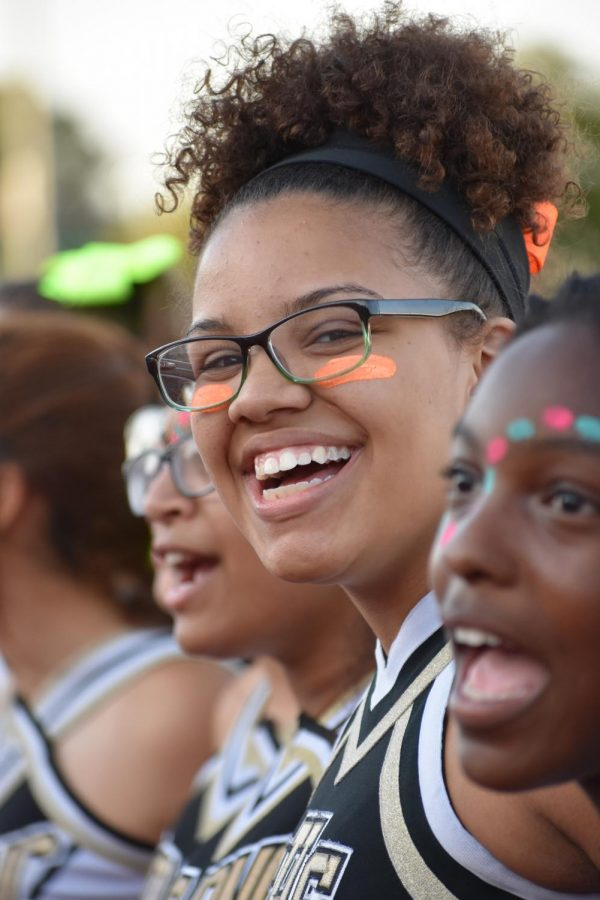 Amari McGlory, junior, smiles during the singing of the school song.