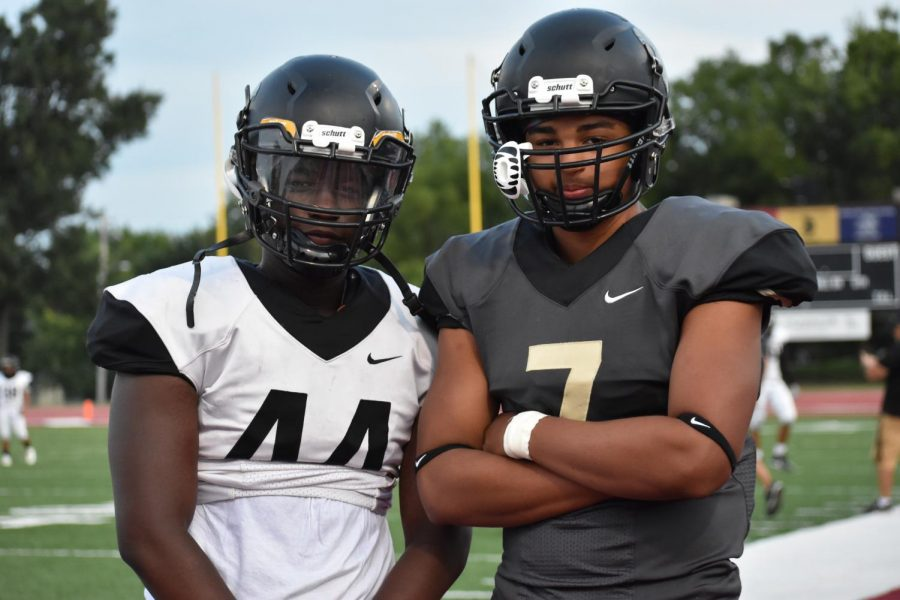 Joel Munganga and Jalen McMurray pose for a photo on the sidelines before the Black and Gold Scrimmage.