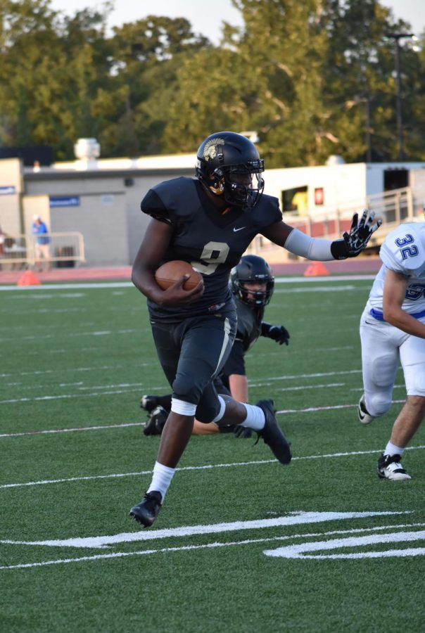 DaVonshai Harden, sophomore, carries the ball down the field.