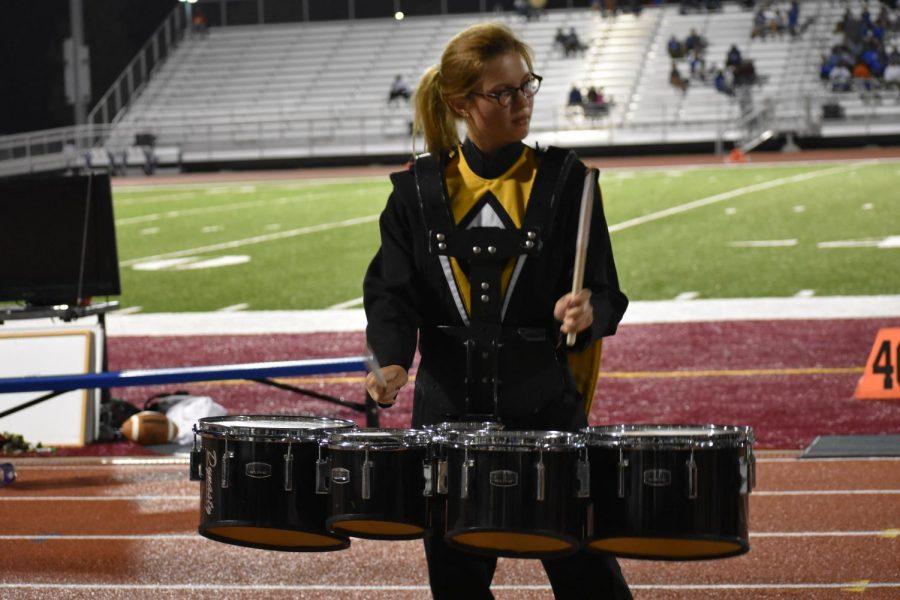 Rachel Stewart, senior, plays the quads in the drumline performance during halftime.