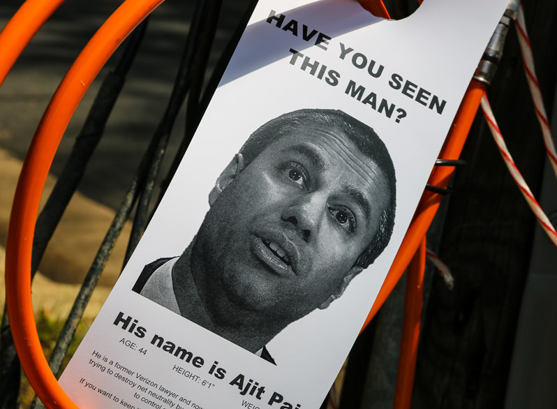 Ajit Pai's face on a bulletin describing his plan to repeal Net Neutrality, placed by Net Neutrality Activists.