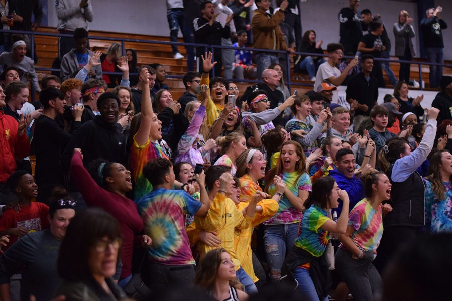 The student section reacts to the game winning shot made by senior, Larry White.