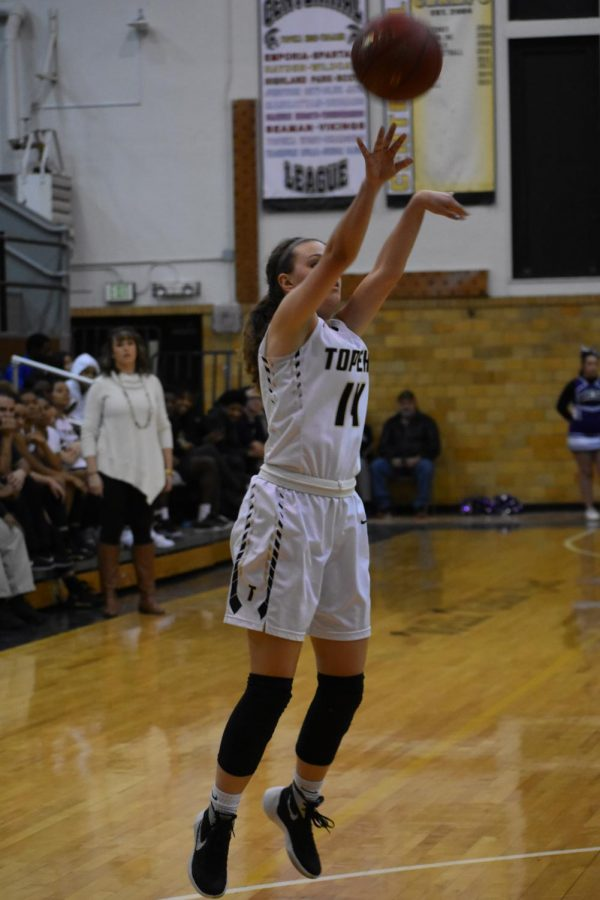 Morgan Carranza, senior and prominent member of the womens varsity team, takes her shot.