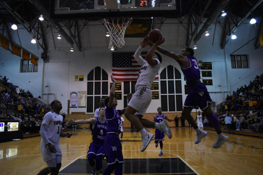 Ky Thomas, sophomore, jumps high to shoot.