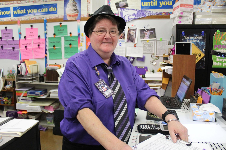 Joleen+Whitfill%2C+math+teacher%2C+smiling+in+her+opposite+day+attire.