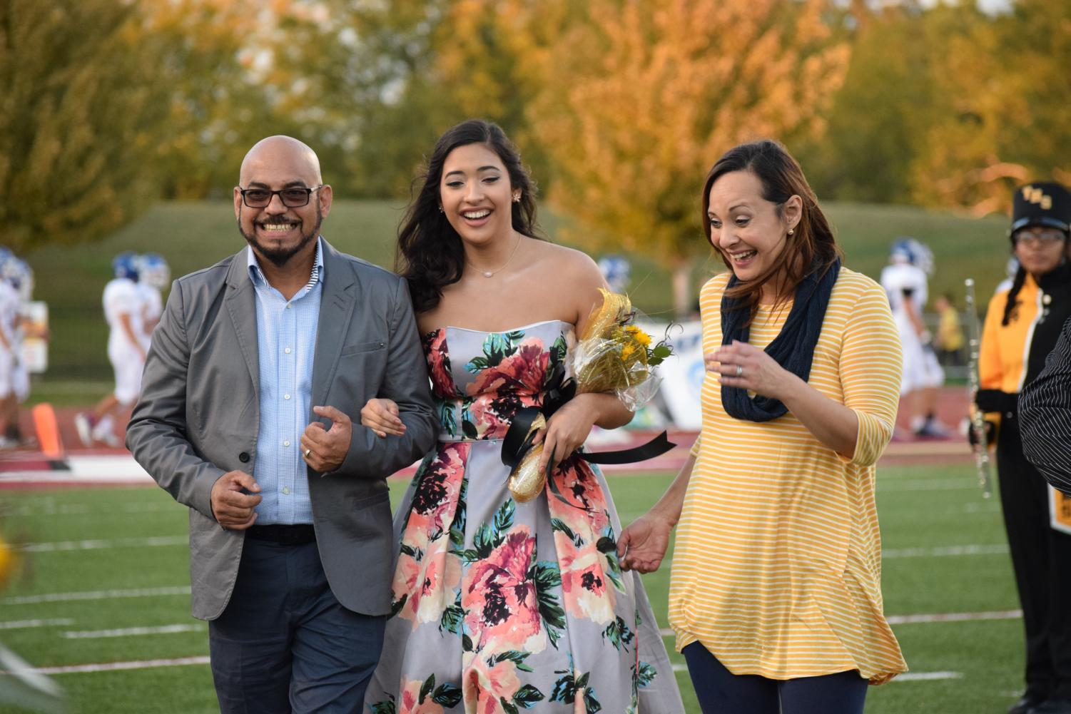 Alexia+Hercules+and+her+parents+respond+her+name+being+announced+as+Homecoming+Queen.