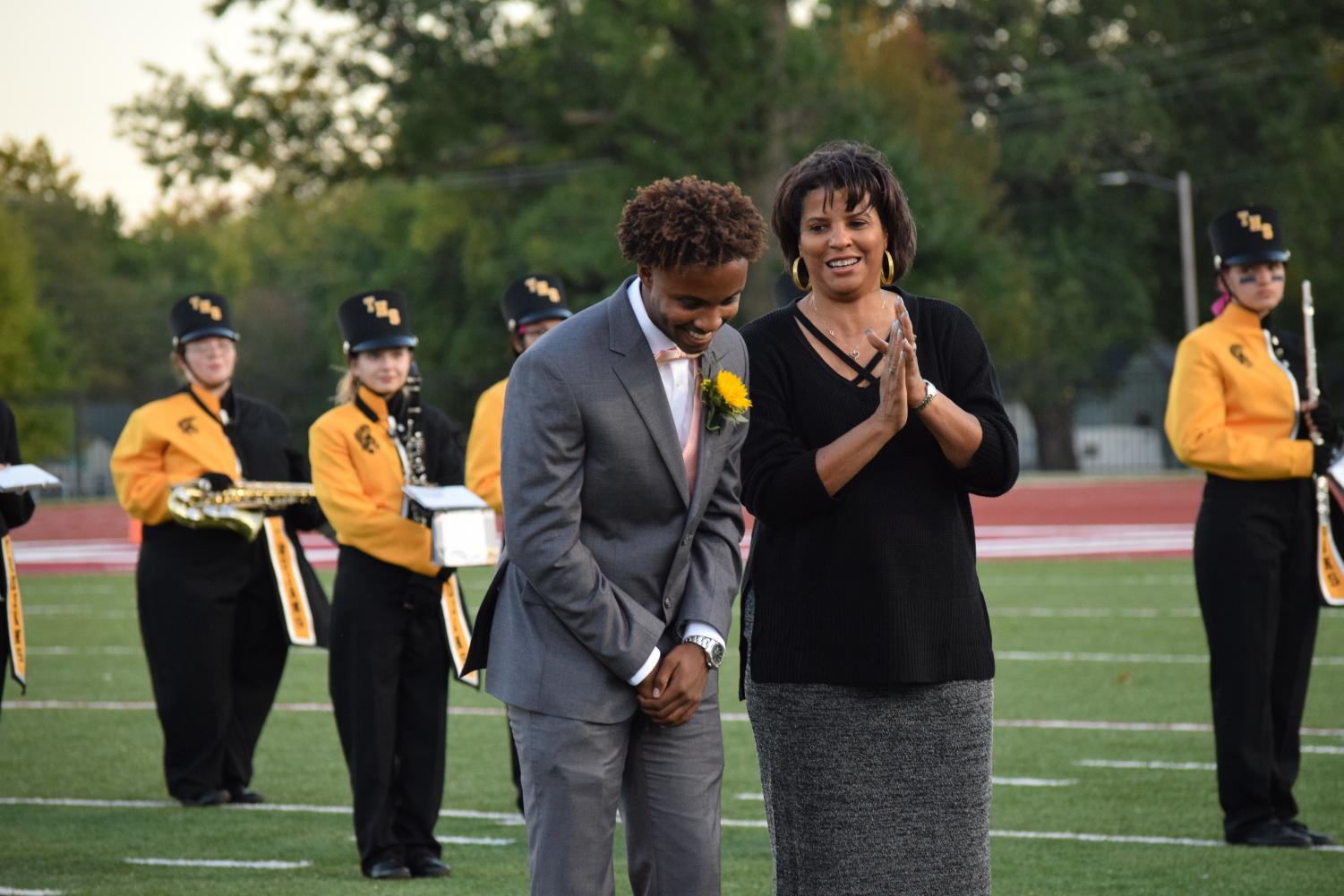 Homecoming+King%2C+Philip+Canady%2C+smiles+as+his+name+is+announced.