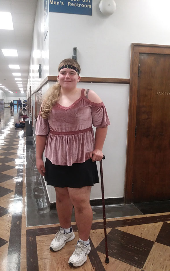 Limping+down+the+hall+due+to+a+football+injury%2C+Jeffrey+Moore%2C+sophomore%2C+flaunts+his+female+clothing.