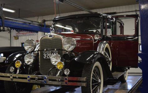 A Ford Model T sits on display on the vehicle lift in the Auto Shop. Photograph by William Hendrix.