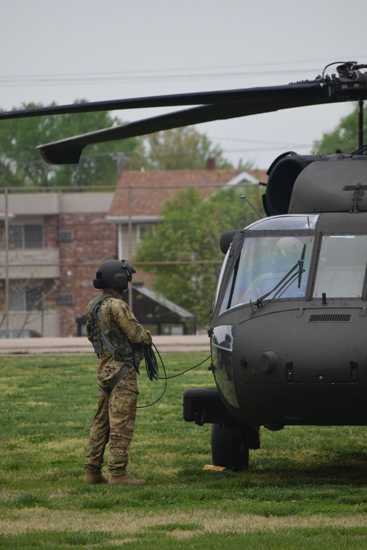 A+National+Guard+pilot+prepares+his+Black+Hawk+for+take+off.