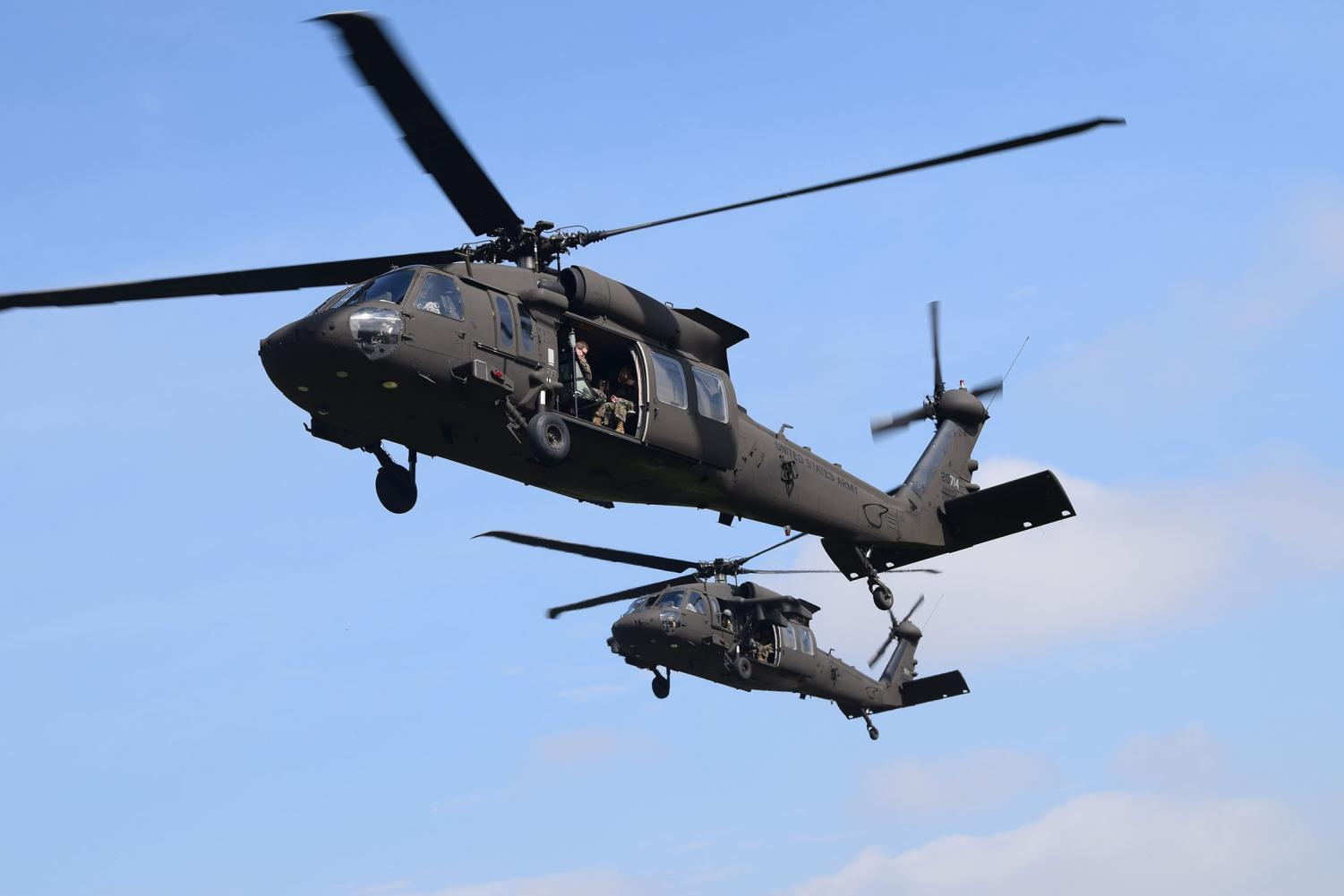 Both+Black+Hawk+helicopters+take+off+in+unison+carrying+roughly+15+cadets+a+piece.+