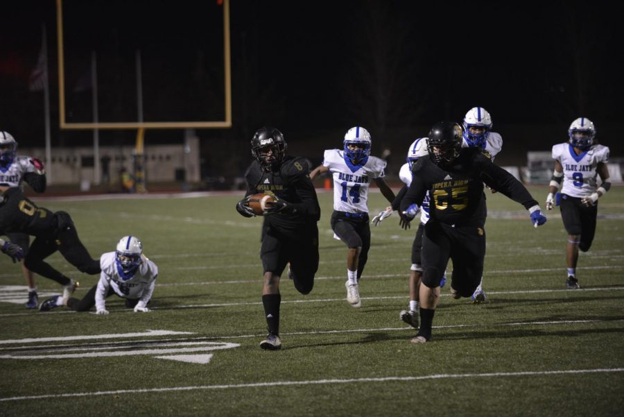 Ky+Thomas+%2812%29+running+down+the+field+as+Myles+Wright+%2811%29+backs+him+up.
